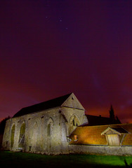 Commanderie of the Knights Templar with red sky. Coulommiers, Seine-et-Marne, France