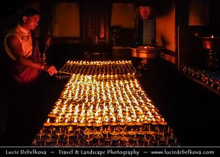 Nepal - Burning Butter Lamps at Swayambhunath Temple