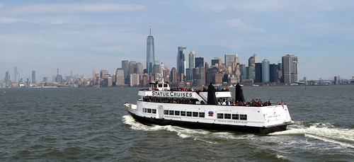 Statue Cruises Near the Statue of Liberty With Manhattan in Background, New York, New York