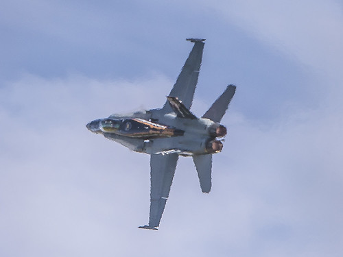 Goodbye !! F/A -18 shimmering in it's afterburner heat.