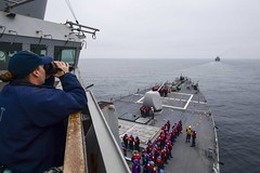 A Sailor measures the distance from USS Ross (DDG 71) to the Turkish Navy ship.