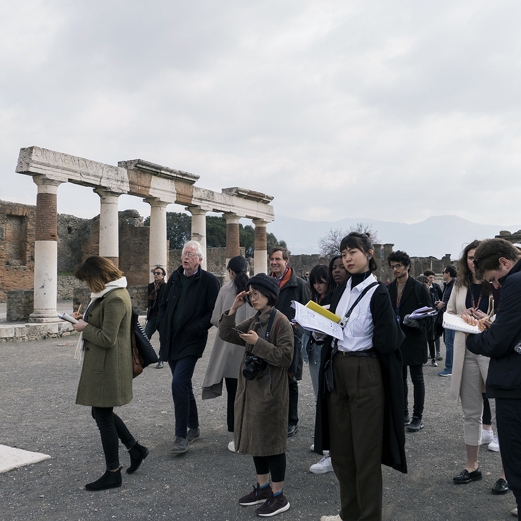Jan Gadeyne and Jeffrey Blanchard lead a tour of Pompeii as students take notes.  photo / Lang Dong (B.Arch. '21)