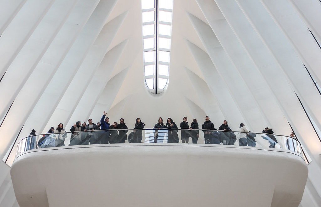 Cornell AAP NYC program director Bob Balder (waving) with students on the balcony at the Oculus in the PATH station.   photo / Allison Bernett (M.Arch. '20)