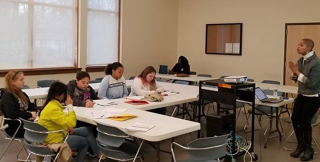 Instructor and WilmU alumna Geneva Fonda teaches Girl Scouts and other middle-through-high-school age girls about the business of money and its applications. (Photo courtesy of Chesapeake Girl Scout Troop #537.)