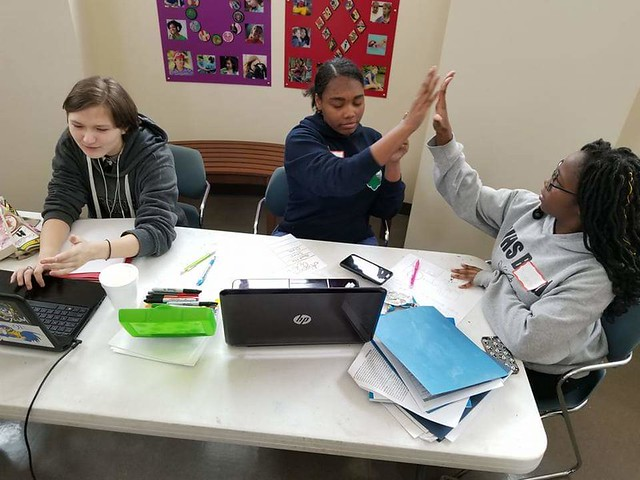 Girls and young women alike support each other as they learn a variety of finance topics, from how to start up a business, to personal budgeting and finance -- even how to become a digital entrepreneur. (Photo courtesy of Chesapeake Girl Scout Troop #537.)