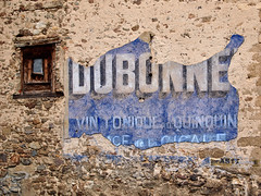 Classic old 'Ghost sign' in remote Querigut, in the Midi-Pyrénées, France.