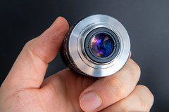 Rear view of a Cosmicar 8mm F1.4 C-mount lens