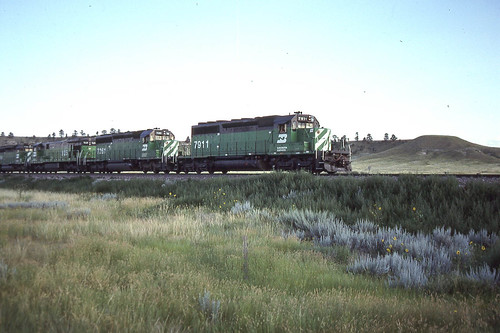 BN SD40-2 #7911 near Orrin WY on 7-27-91.  Just south of Douglas WY where we stayed a couple of nights.  Coal Country!
