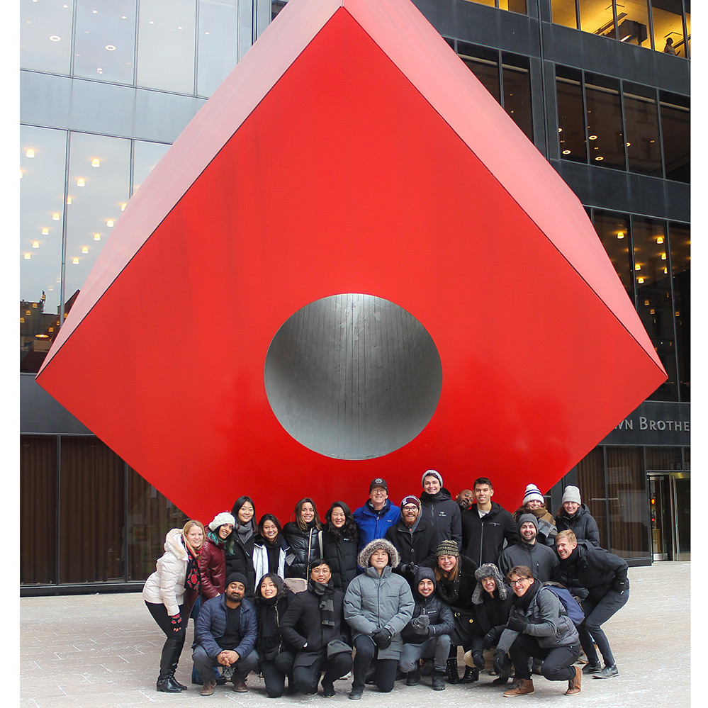 AAP NYC students stop for a group photo in front of the Isamu Noguchi sculpture at 140 Broadway.  photo / Allison Bernett (M.Arch. '20)