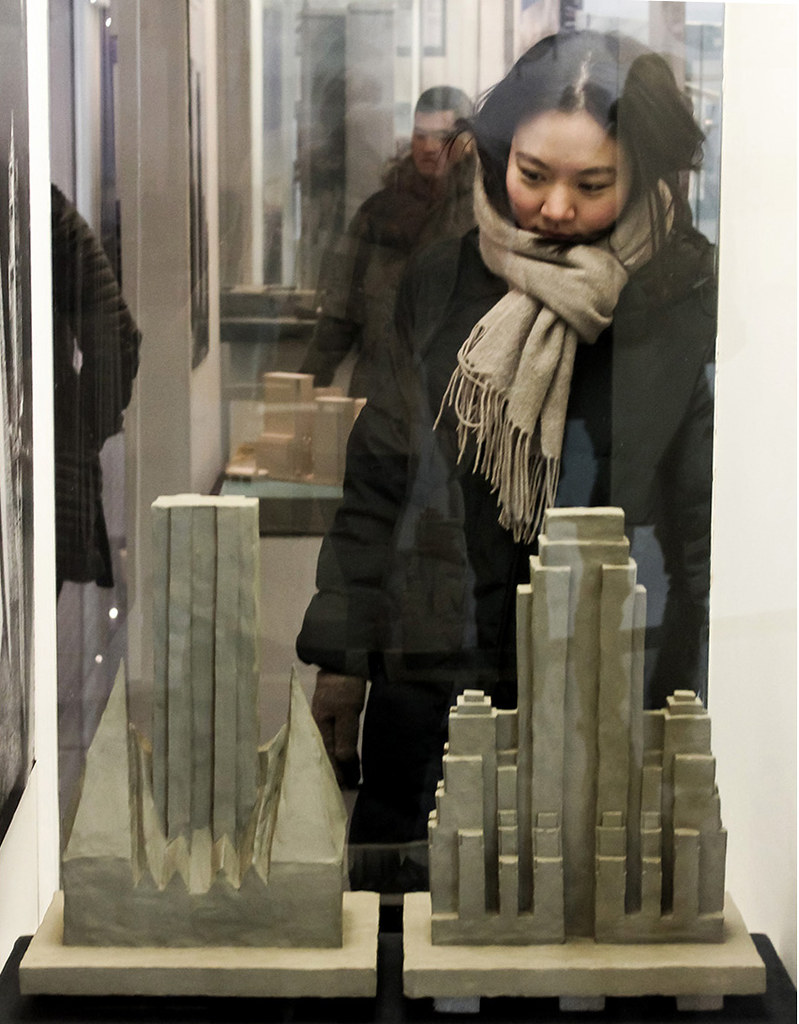 Chae Park (M.Arch. '20) studies models at the Skyscraper Museum during a neighborhood tour led by program director Bob Balder (B.S. URS '89).   photo / Allison Bernett (M.Arch. '20)