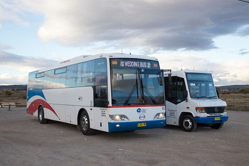 QCity (6385) Hino RN8J/P&D and (1796) Mercedes Benz 815D/CC CB20 posed for a photo at the park and ride in Fyshwick