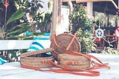 Handmade natural organic rattan handbag. Tropical island of Bali. Eco-bag concept. Ecobags from Bali.