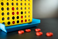 Connect four game over a black surface