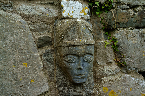 Sculpted head, re-used as building block