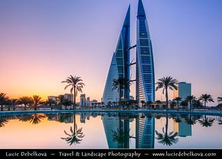 Bahrain - Sunrise next to Bahrain World Trade Center Reflected in Water Fountain