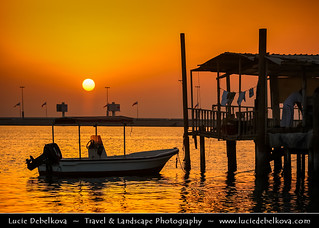 Bahrain - Sunset over traditional fisherman village at Muharraq