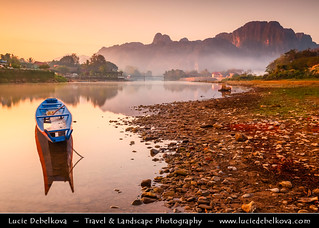 Laos - Lonely Fisherman on Mekong River in Vientiane at the Sunset