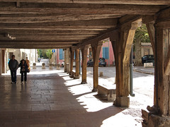 The spacious arcades surrounding the market place, supported by immense timbers at Mirepoix, France - Photo of Lagarde
