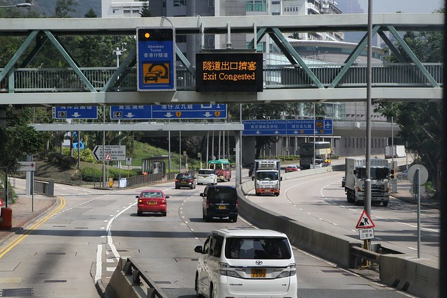 Road sign on Wong Chuk Hang Road, flashing amber lights indicate congestion in the Aberdeen Tunnel