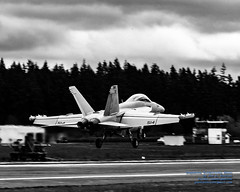 A VAQ-129 GROWLER A FRACTION OF A SECOND FROM TOUCHING AT OLF