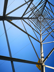 Transmission tower against a blue sky