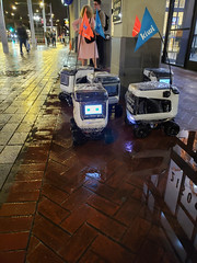 Robots huddle out of the rain