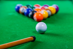 Playing Billiards with balls on the table