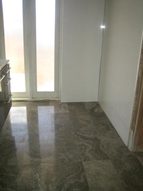 dark-silver-travertine-laid-and-polished