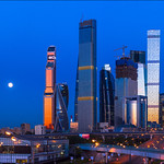 Russia. Moscow. Full moon and Moscow-City.