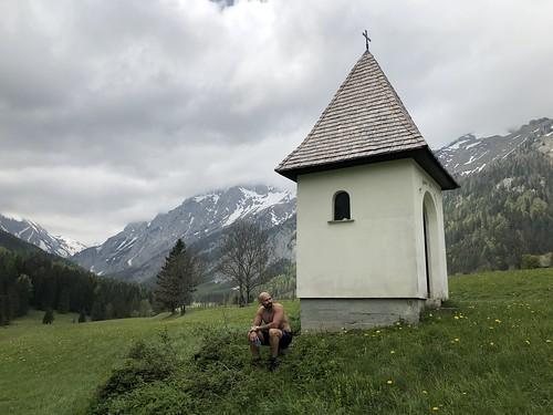 Alejandro seated by the chapel, Untere Dullwitz bei Seewiesen, Austria