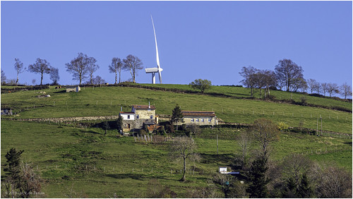 A wind turbine behind the mountain