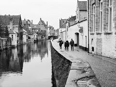 Family Walking in Bruges Belgium - B&W