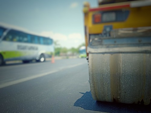 Road maintenance by burning old materials and improving quality