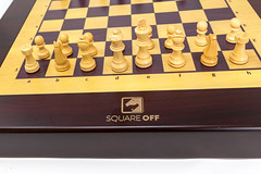 Close-up of the white chess pieces of Square Off, the world's smartest chessboard and e-sport