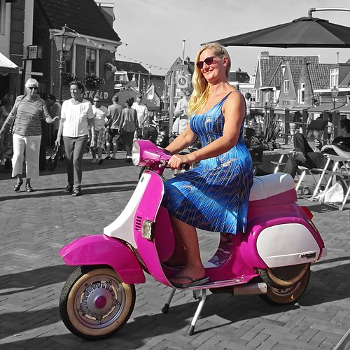 Vespa PK50 scooter with willing woman