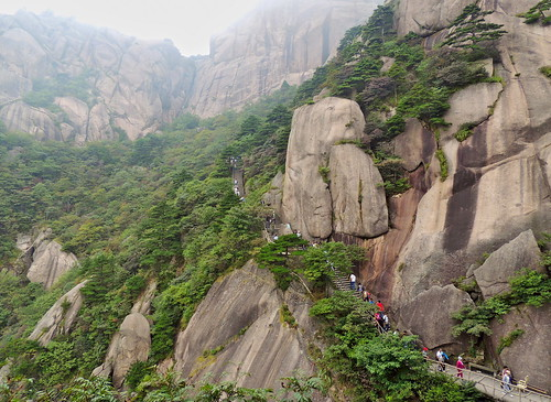 Stairs climbing the Huangshan Yellow Mountain granite cliffs and forest, China