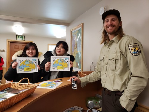 Tourists show off certificates