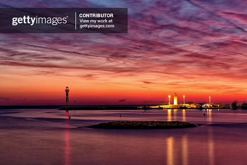 lighthouse of Cannes by night with beatiful sunset