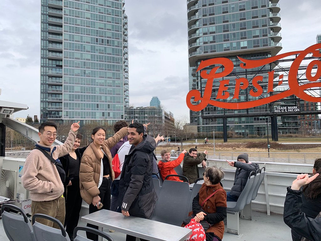 Students visit the Pepsi-Cola sign in Queens.  photo / Thomas J. Campanella