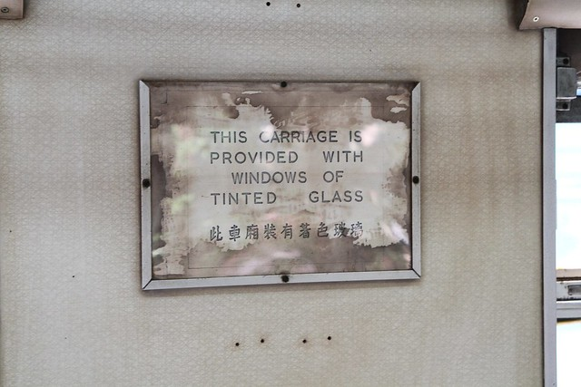 'This carriage is provided with windows of tinted glass' notice onboard 1964 first-class coach #112
