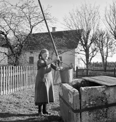 Woman at a well, Norrlanda, Gotland, Sweden