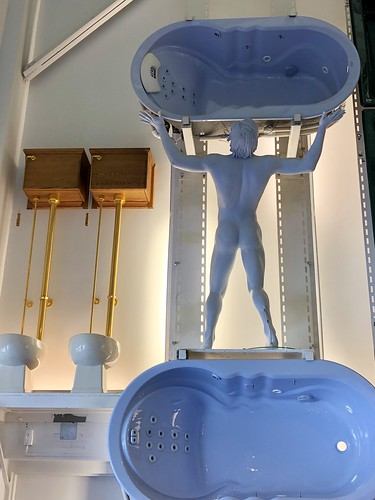 Atlas tubbed? Nude male mannequin supports a bathtub, Kohler Design Center, Kohler, Wisconsin