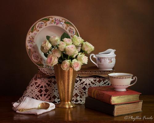 Still life roses in gold vase