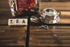 Word TEA with tea dispenser and tea bag