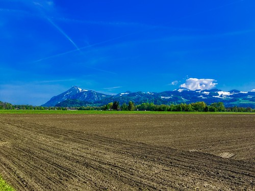 Fields between Kiefersfelden and Oberaudorf with mountain range in the distance in Bavaria, Germany