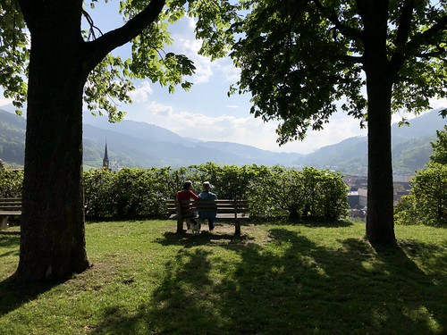 Couple on a bench, May afternoon at Landskron Castle, Bruck an der Mur, Austria