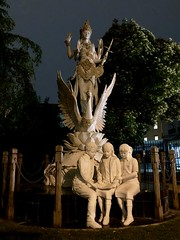 Dewi Saraswati, goddess statue by Embassy of Indonesia, night in Washington, D.C.