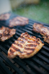 Grilled pork steak on a barbecue