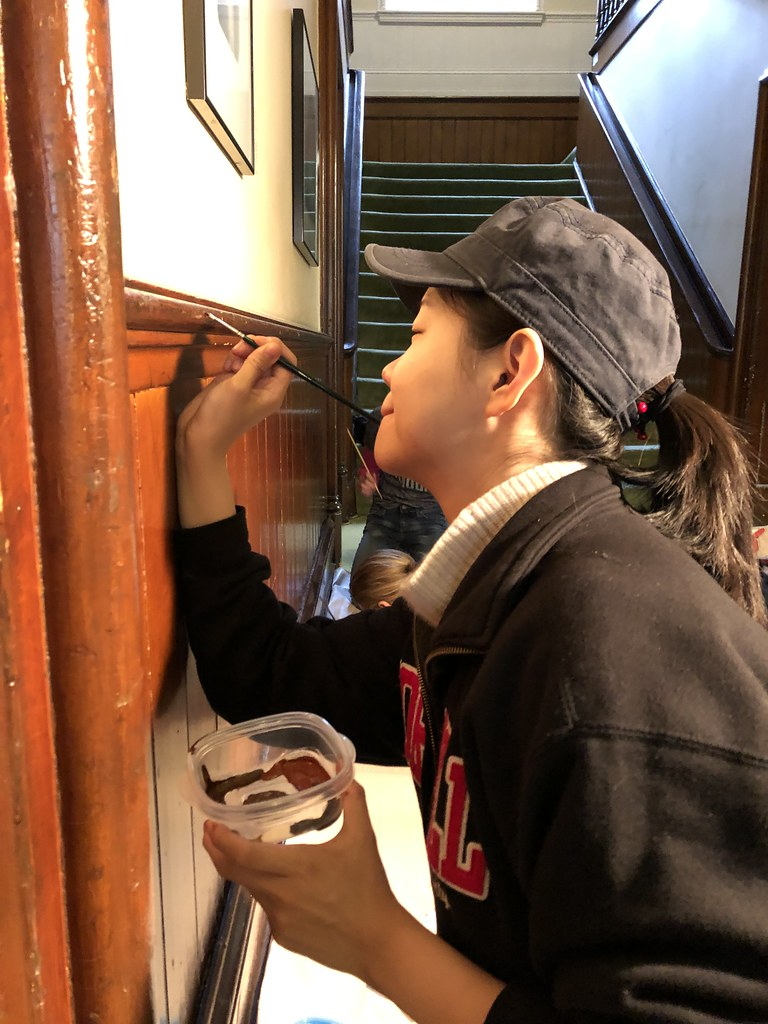 Shiyuan Chen (M.R.P. '20) restores some woodwork at the Oneida Community Mansion House during CRP's Work Weekend.  photo / Dorothy Qian (M.R.P. '20)