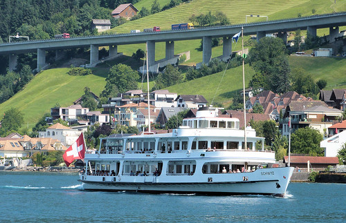 Lake Lucerne Navigation Company, Switzerland - MS Schwyz leaving Beckenreid with the 15.12 from Flüelen to Luzern with the Luzern to Gotthard Motorway in the background on the 13th July 2018